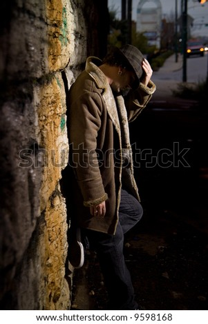 Man in alley - stock photo