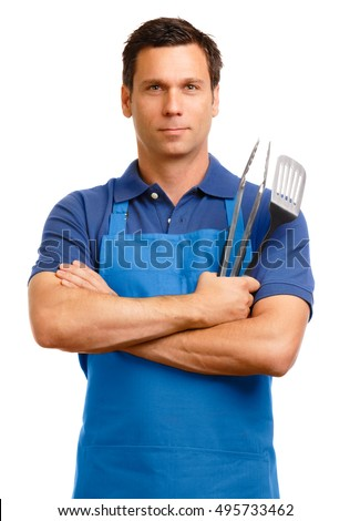 Man in apron with cooking utensils on white