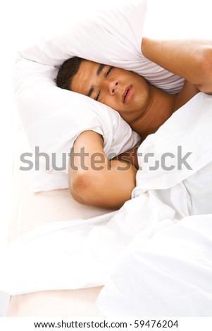 Man in bed - stock photo