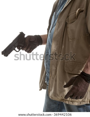 Man in black gloves with a gun in hand isolated on white background - stock photo