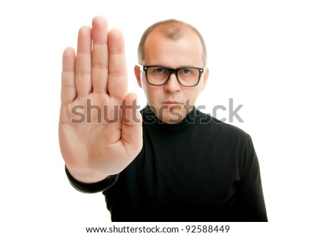 Man in black showing rejective hand gesture, isolated on white - stock photo