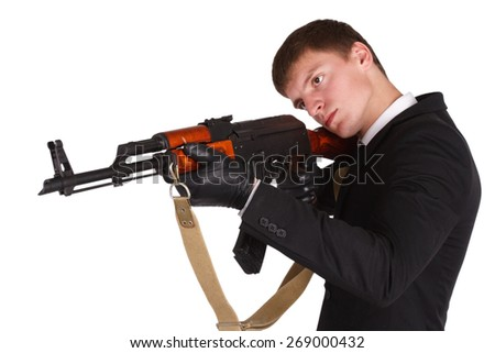 man in black suit and ak 47 isolated on white