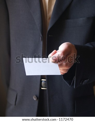 Man in black suit showing a blank card;vertical