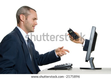 man in blue suit in office taking an internet call