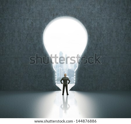 man in bulb-shaped doorway - stock photo