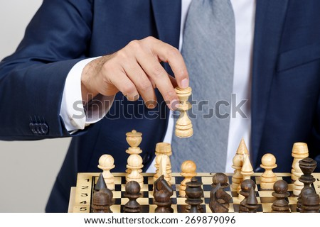 man in business suit playing chess