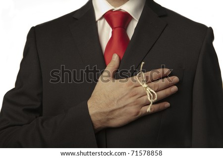 man in business suit with a knot around his finger to make him remember something! - stock photo