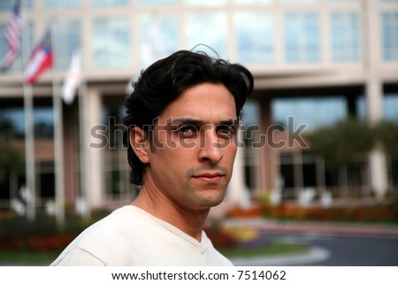 Man in casual business atire standing outside - stock photo