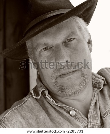 Man in cowboy hat in black and white