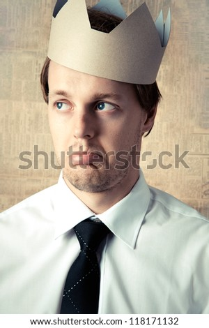 Man in crown feeling sad disappointed upset unhappy, about to cry - stock photo