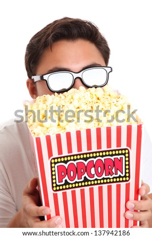 Man in 3d glasses holding a popcorn bucket. Wearing a white t-shirt. White background.