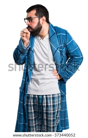 Man in dressing gown coughing a lot - stock photo