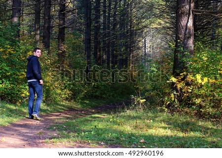 Man in forest. Man on trail. Human