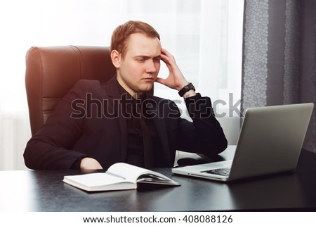 Man in formal clothes has brainstorm at his office