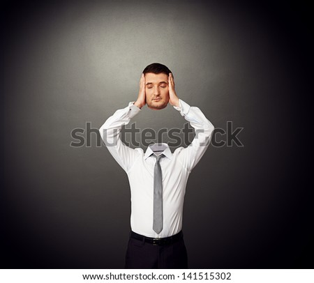 man in formal wear holding his sleeping head in hands - stock photo