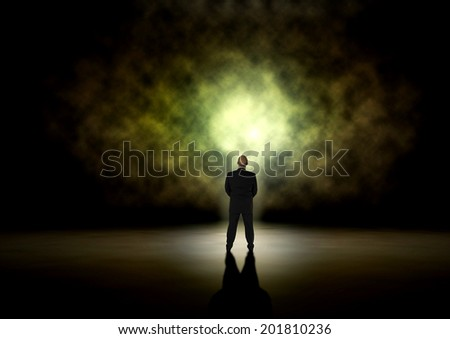 Man in front of a mystical light - stock photo
