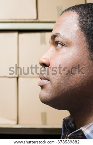 Man in front of cardboard boxes - stock photo