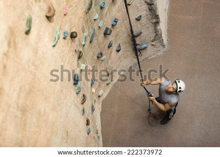 Man in Front of Climbing Wall - stock photo
