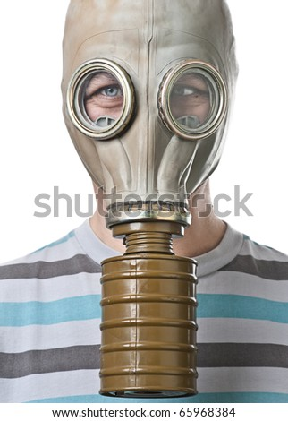 Man in gas mask squinting against white background - stock photo