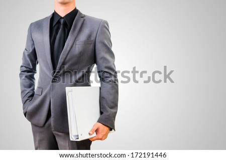 man in gray suit holding file with right copy space