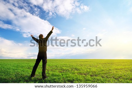 Man in green meadow. Element of design. - stock photo