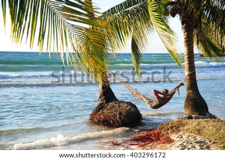 Man in hammock on the beach