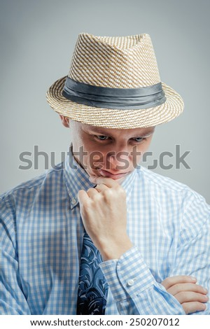 man in hat thinking - stock photo