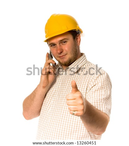Man in helmet talking by mobile phone - stock photo