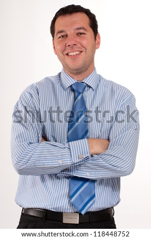 Man in his 30�¢??s wearing a blue stripped shirt and tie - stock photo