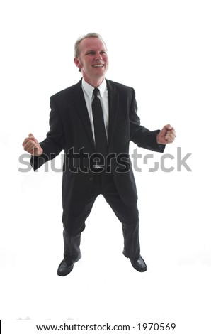 Man in his thirties wearing a smart black suit and tie. Happy winning gesture. Studio shot on white background.