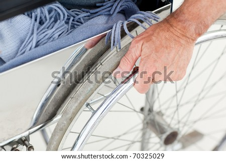 Man in his wheelchair at home