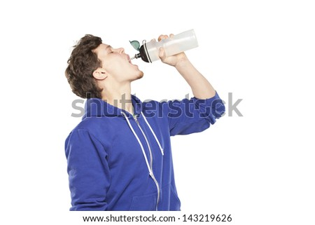 Man in hoodie drinking water isolated background