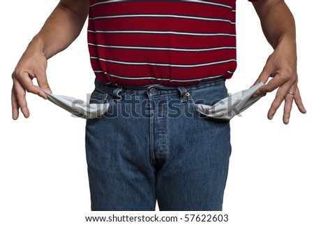 man in jeans, turning his pockets inside out to show he is poor. Isolated on white, saved with clipping path - stock photo