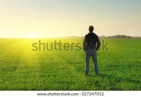 Man in meadow green meadow. Conceptual scene. - stock photo