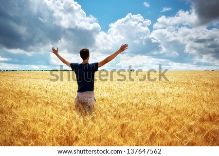 Man in meadow of wheat. Conceptual composition. - stock photo