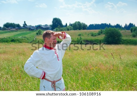 man  in national Russian clothes  in countryside - stock photo