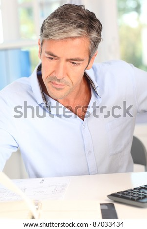 Man in office checking agenda