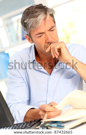Man in office with worried look on his face
