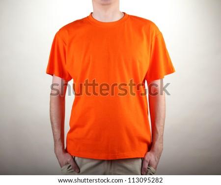 man in orange T-shirt close-up - stock photo