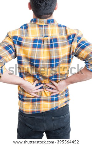 Man in pain with hands holding lower back suffering from lumbar injury isolated on white background - stock photo