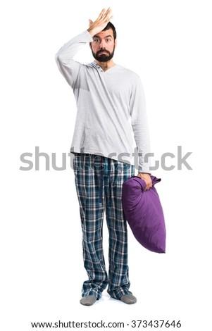 Man in pajamas having doubts - stock photo
