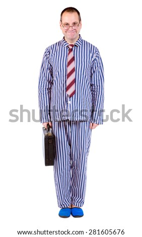 man in pajamas standing at attention, isolated on white background - stock photo