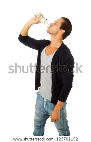 Man in profile drinking fresh water. Isolated on white - stock photo