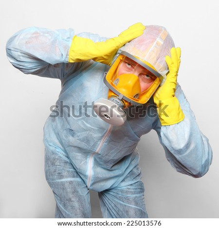 Man in protective clothing with gas mask. Infection control and allergy concept.  - stock photo