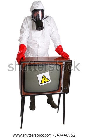 Man in protective suit with retro TV set isolated on white - stock photo