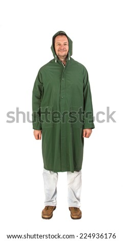 Man in rain green long coat. Isolated on a white background. - stock photo