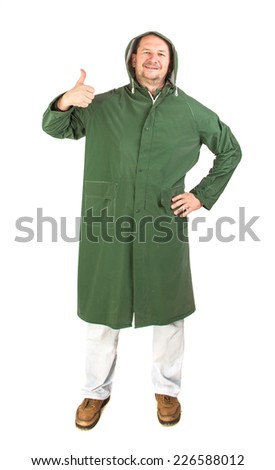Man in rain green long coat. Isolated on a white background.