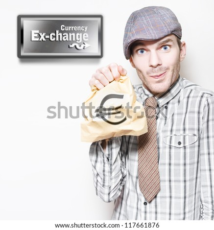 Man In Recession Clothing Holding Bag Of Euro Currency At Money Exchange In A Depiction Of The European Sovereign Debt Crisis Or Eurozone Crisis - stock photo