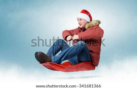 Man in red cap Santa Claus on a sledge, concept sledging - stock photo