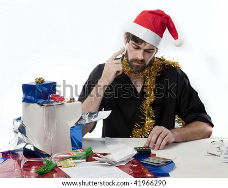 Man in Santa Hat considering his Xmas budget - stock photo